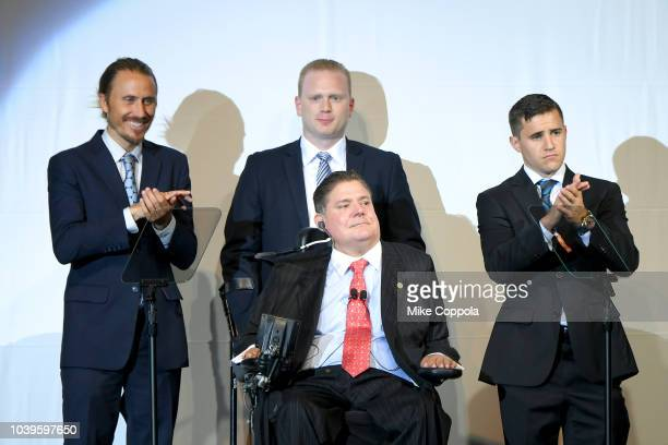 Bryan Bedder Tom Smith Jorge Valdes and Marc Buoniconti speak on stage during the 33rd Annual Great Sports Legends Dinner which raised millions of...