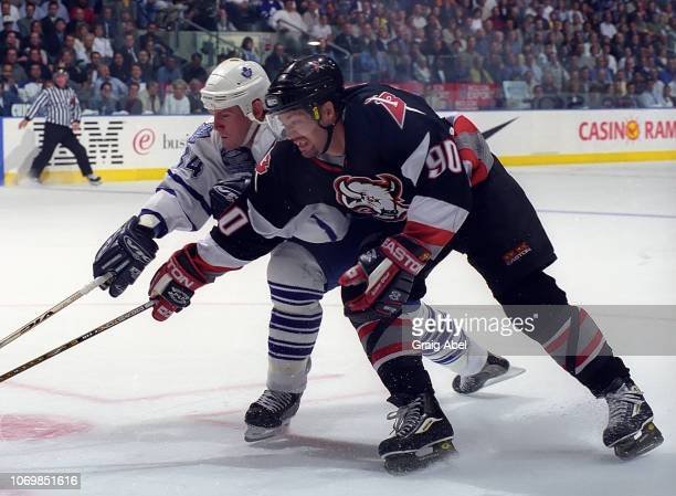 Bryan Berard of the Toronto Maple Leafs skates against Joe Juneau of the Buffalo Sabres during the 1999 NHL SemiFinal playoff game action at Air...