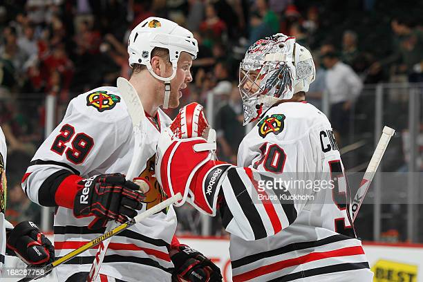 Bryan Bickell and goalie Corey Crawford of the Chicago Blackhawks celebrate after shutting out the Minnesota Wild in Game Four of the Western...
