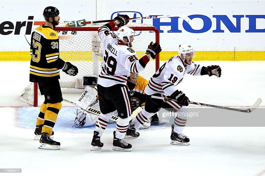 Bryan Bickell #29 and Jonathan Toews #19 of the Chicago Blackhawks celebrate after Brent Seabrook #7 (not pictured) scores the game winning goal against Tuukka Rask #40 of the Boston Bruins in overtime in Game Four of the 2013 NHL Stanley Cup Final at TD Garden on June 19, 2013 in Boston, Massachusetts.