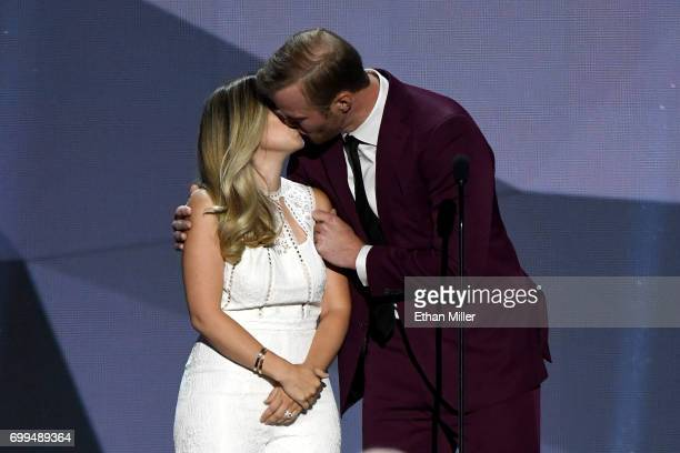 Bryan Bickell and wife Amanda Bickell kiss onstage during the 2017 NHL Awards and Expansion Draft at TMobile Arena on June 21 2017 in Las Vegas Nevada