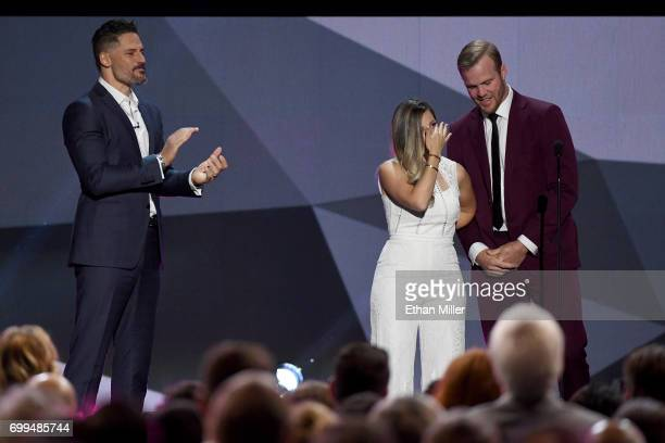 Bryan Bickell and wife Amanda Bickell speak onstage alongside host Joe Manganiello during the 2017 NHL Awards and Expansion Draft at TMobile Arena on...