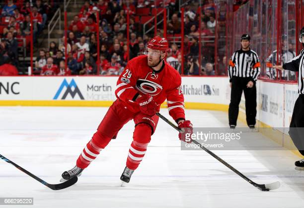 Bryan Bickell of the Carolina Hurricanes controls the puck across the blue line during an NHL game against the St Louis Blues on April 8 2017 at PNC...