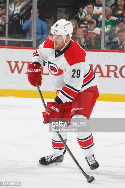 Bryan Bickell of the Carolina Hurricanes handles the puck against the Minnesota Wild during the game on April 4 2017 at the Xcel Energy Center in St...