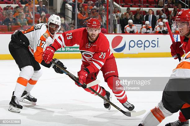 Bryan Bickell of the Carolina Hurricanes skates for position off a face against the Philadephia Flyers on October 30 2016 at PNC Arena in Raleigh...