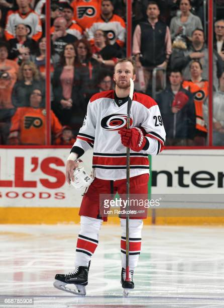 Bryan Bickell of the Carolina Hurricanes stands on the blue line during the National Anthem prior to the start of his game against the Philadelphia...