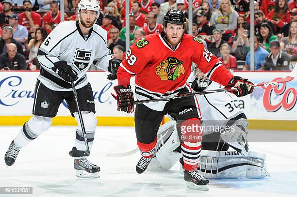 Bryan Bickell of the Chicago Blackhawks and Jake Muzzin of the Los Angeles Kings watch for the puck in Game Two of the Western Conference Final...