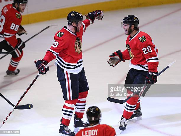 Bryan Bickell of the Chicago Blackhawks celebrates his goal with teammate Brandon Saad in the second period of Game Two of the Western Conference...