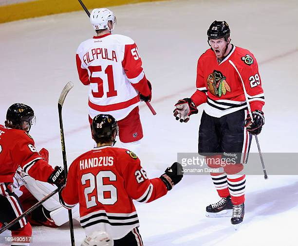 Bryan Bickell of the Chicago Blackhawks celebtrates his first period goal with Patrick Kane and Michal Handzus against the Detroit Red Wings in Game...