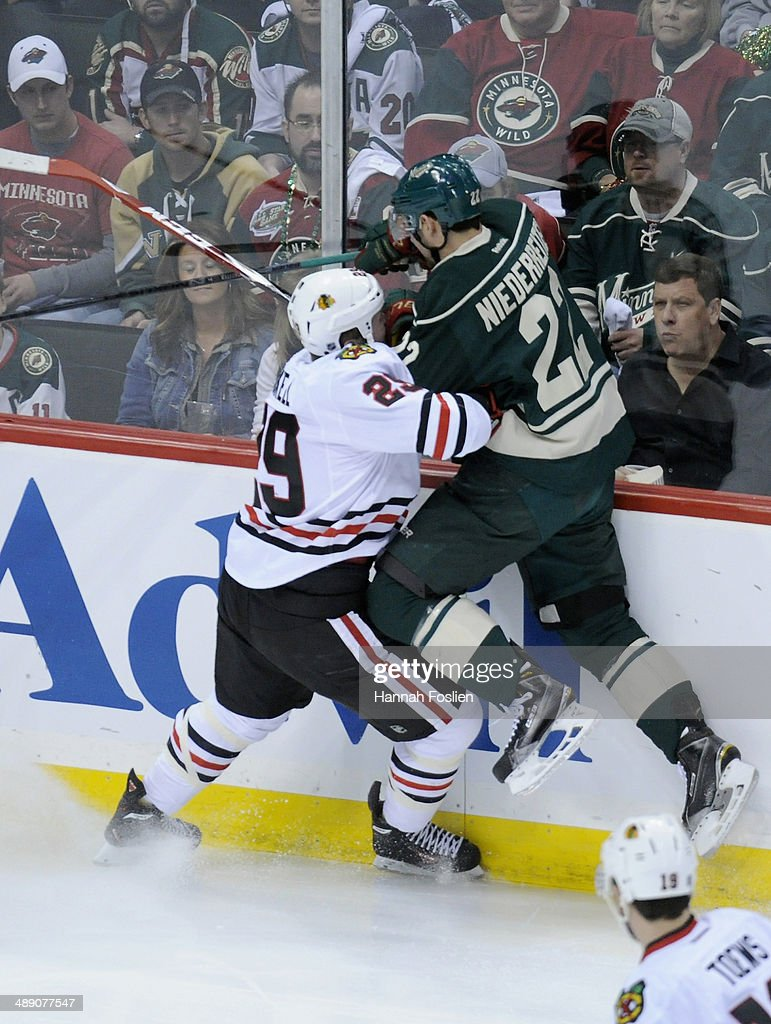 Bryan Bickell #29 of the Chicago Blackhawks checks Nino Niederreiter #22 of the Minnesota Wild into the boards during the first period in Game Four of the Second Round of the 2014 NHL Stanley Cup Playoffs on May 9, 2014 at Xcel Energy Center in St Paul, Minnesota. The Wild defeated the Blackhawks 4-2.