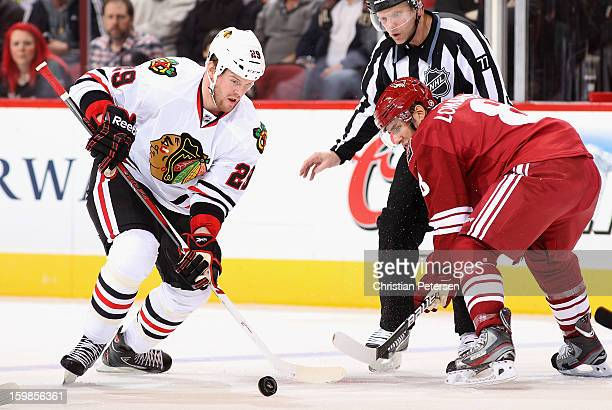 Bryan Bickell of the Chicago Blackhawks faces off against Matthew Lombardi of the Phoenix Coyotes during the NHL game at Jobingcom Arena on January...