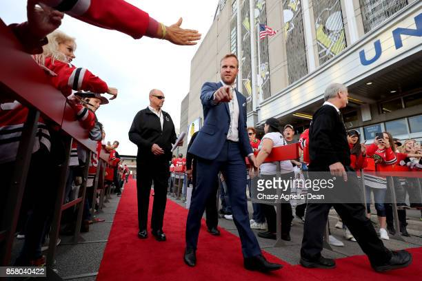 Bryan Bickell of the Chicago Blackhawks walks the red carpet prior to the game against the Pittsburgh Penguins at the United Center on October 5 2017...