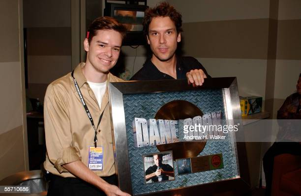 Bryan Billig and comedian Dane Cook celebrate Dane Cook's gold record at the Madison Square Garden Theater on September 17 2005 in New York City
