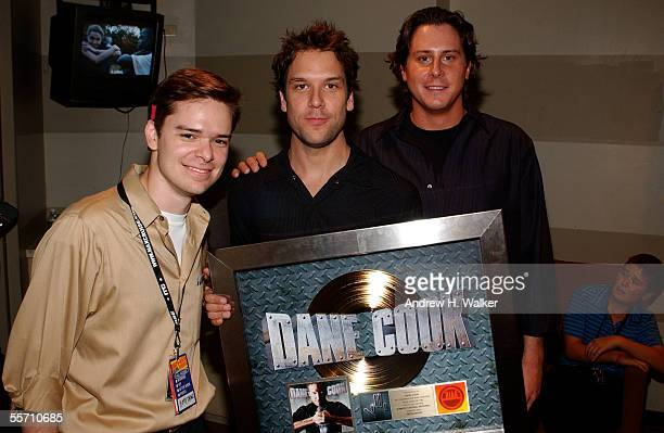 Bryan Billig comedian Dane Cook and Matt Frost celebrate Dane Cook's gold record at the Madison Square Garden Theater on September 17 2005 in New...