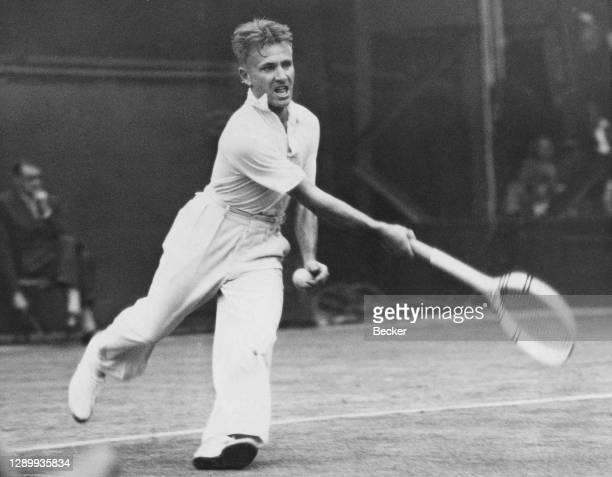 """Bryan """"Bitsy"""" Grant of the United States makes a forehand return against Fred Perry during their Men's Singles Quarter Final match at the Wimbledon..."""