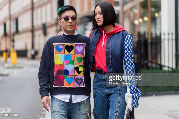 Bryan Boy and Tiffany Hsu outside JW Anderson during London Fashion Week September 2017 on September 16 2017 in London England