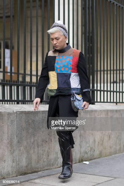 Bryan Boy is seen on the street attending Noir Kei Ninomiya during Paris Women's Fashion Week A/W 2018 wearing a multicolor patch sweater on March 3...