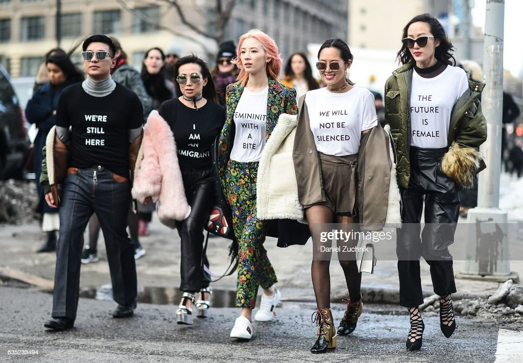Bryan Boy, Tina Craig, Irene Kim, Aimee Song and Chriselle Lim are seen making a political statement outside of the 3.1 Phillip Lim show during New York Fashion Week: Women's Fall/Winter 2017 on February 13, 2017 in New York City.