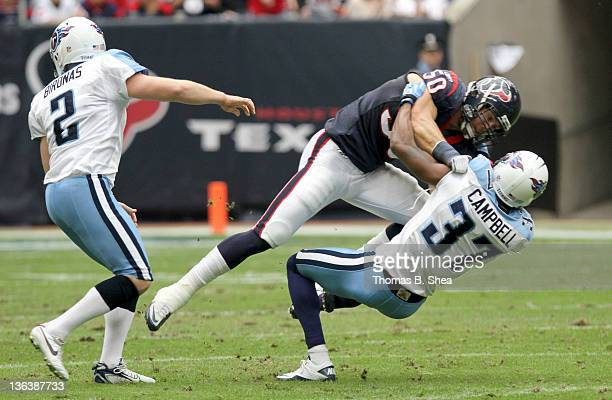 Bryan Braman of the Houston Texans wrestles player Tommie Campbell of the Tennessee Titans on a kick off on January 1 2012 at Reliant Stadium in...