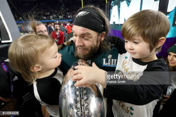 Bryan Braman of the Philadelphia Eagles celebrates with his kids and the Vince Lombardi Trophy after defeating the New England Patriots 4133 in Super...