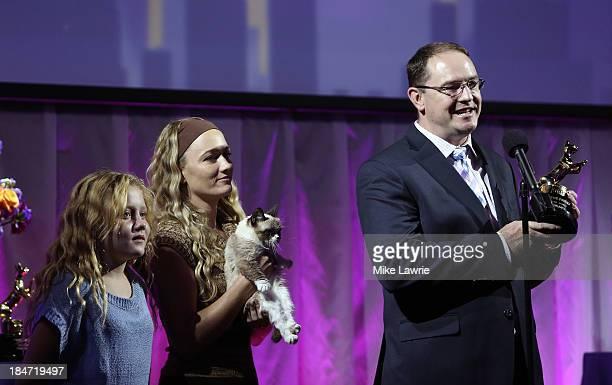 Bryan Bundesen accepts the Lifetime Achievement Award for Grumpy Cat as Chrystal Bundesen and Tabatha Bundesen look on during The Friskies 2013 at...