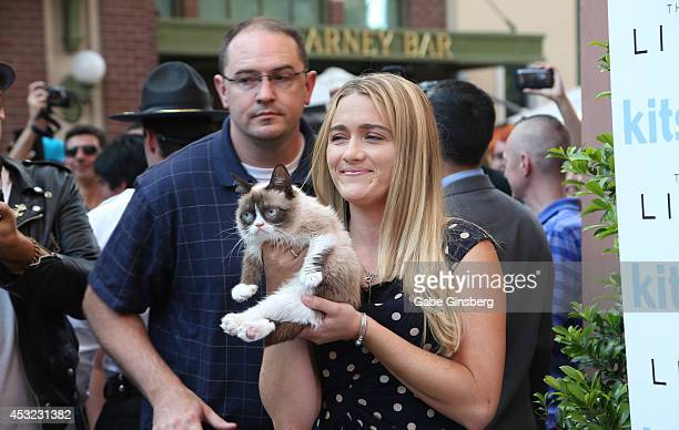 Bryan Bundesen and his sister Tabatha Bundesen holding Grumpy Cat as they arrive at The Grumpy Guide to Life Observations By Grumpy Cat book launch...