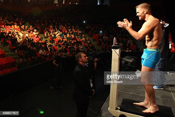 Bryan Caraway of the United States steps on the scale during the UFC Fight Night weighin at the Scotiabank Centre on October 3 2014 in Halifax Nova...