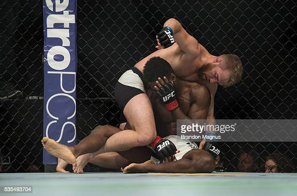Bryan Caraway punches Aljamain Sterling in their bantamweight bout during the UFC Fight Night event inside the Mandalay Bay Events Center on May 29...