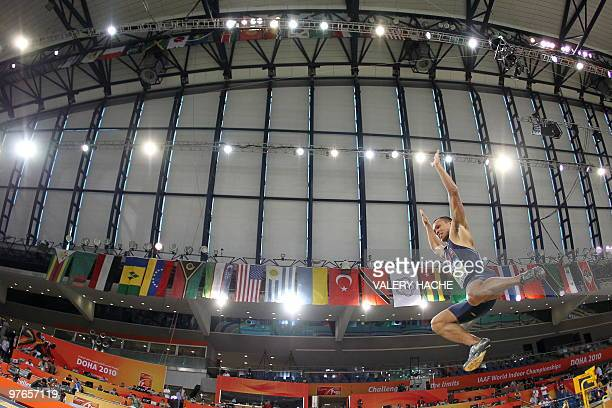 Bryan Clay competes in the men's heptathlon long jump event at the 2010 IAAF World Indoor Athletics Championships at the Aspire Dome in the Qatari...
