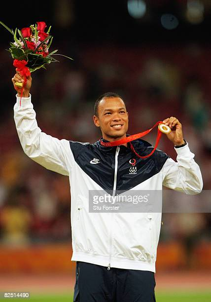 Bryan Clay of the United States holds his gold medal after the Men's Decathlon event at the National Stadium on Day 14 of the Beijing 2008 Olympic...