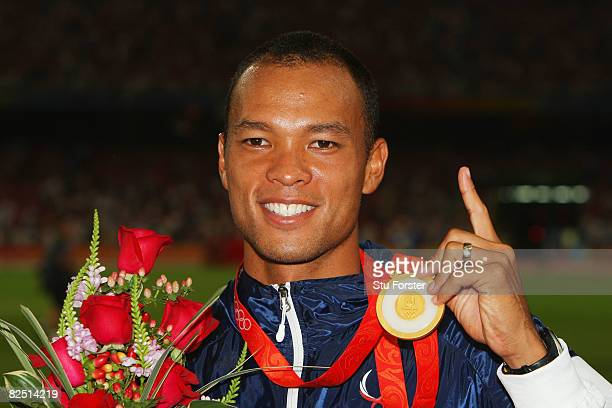 Bryan Clay of the United States holds up his gold medal after the Men's Decathlon event at the National Stadium on Day 14 of the Beijing 2008 Olympic...