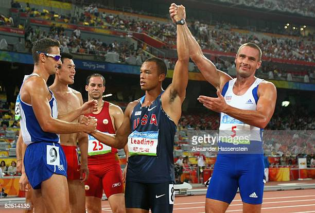 Bryan Clay of the United States is congratulated by fellow competitors after his victory in the Men's Decathlon event at the National Stadium on Day...
