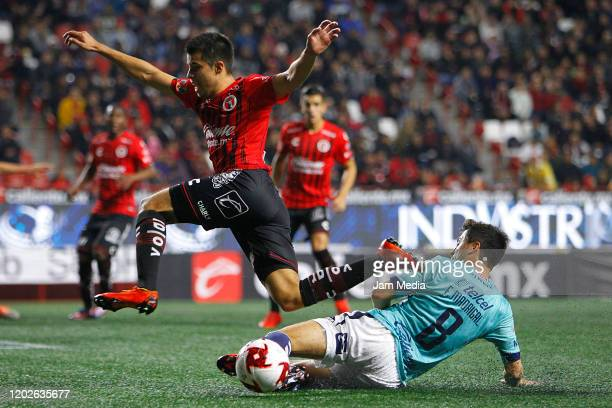 Bryan Colula of Tijuana fights for the ball with Fernando Madrigal of San Luis during a match between Tijuana and Atletico San Luis as part of the...