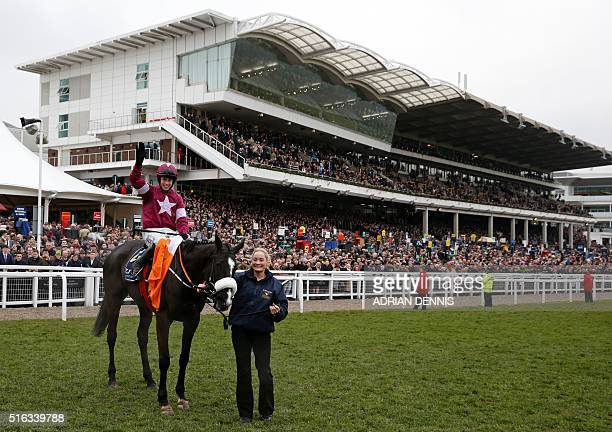 Bryan Cooper celebrates on Don Cossack in front of the packed grandstand after his victory in the Cheltenham Gold Cup on the final day of the...