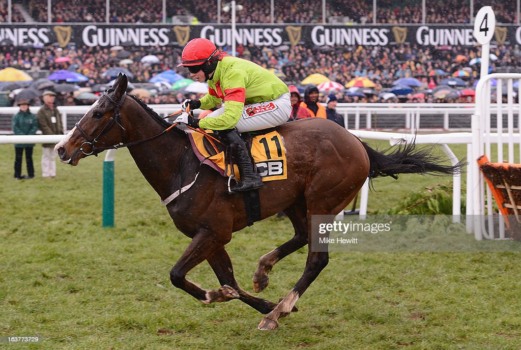 Bryan Cooper guides Our Conor to victory in the JCB Triumph Hurdle at Cheltenham Racecourse on March 15, 2013 in Cheltenham, England.