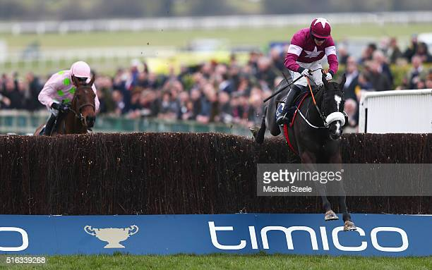 Bryan Cooper on Don Cossack clears the last from Djakadam ridden by Ruby Walsh on the way to winning the Timico Cheltenham Gold Cup Chase as part of...