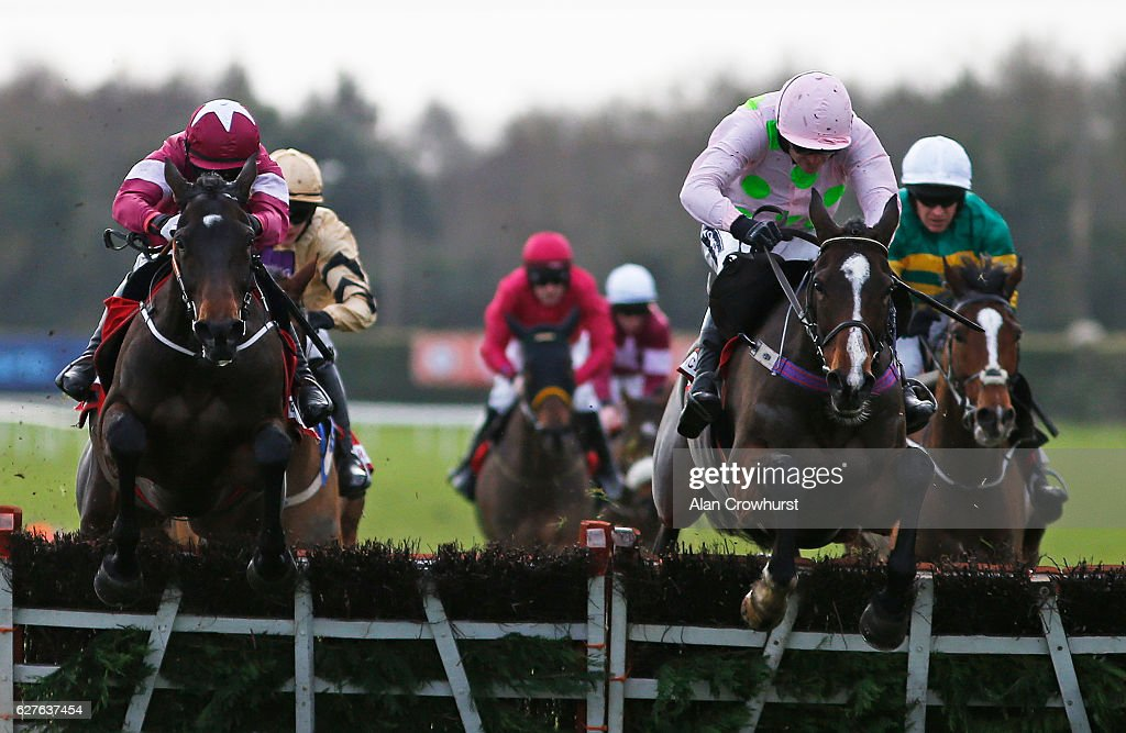 Bryan Cooper riding Apple's Jade (L) clear the last to win The Bar One Racing Hatton's Grace Hurdle from Vroum Vroum Mag (C, pink) at Fairyhouse racecourse on December 4, 2016 in Dublin.