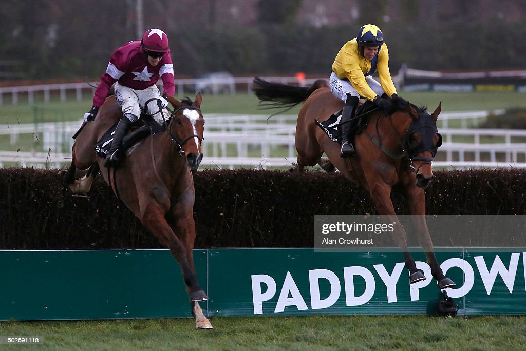 Bryan Cooper riding Don Poli (L) clear the last to win The Lexus Steeplechase at Leopardstown racecourse on December 28, 2015 in Dublin, Ireland.
