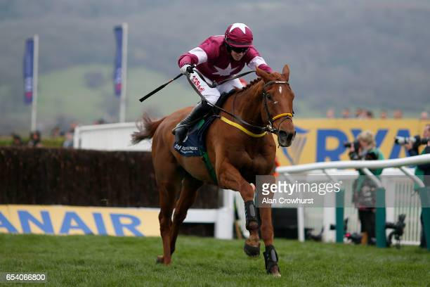 Bryan Cooper riding Road To Respect clear the last to win The Brown Advisory merriebelle Stable Plate Handicap Steeple Chase during St Patrickâs...