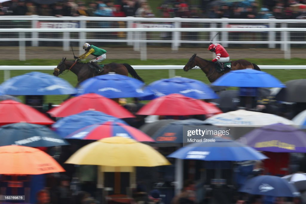 Bryan Cooper (L) riding Ted Veale on his way to winning the Vincent O'Brien County Handicap Hurdle Race from Paul Townend (R) riding Tennis Cap during Gold Cup day at Cheltenham Racecourse on March 15, 2013 in Cheltenham, England.