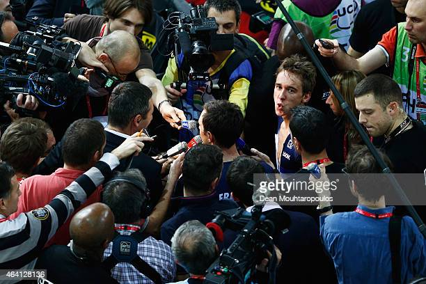 Bryan Coquard and Morgan Kneisky are surrounded by the French media after they compete and win the gold medal and world championship in the Mens...