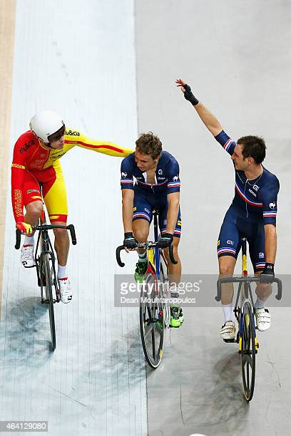 Bryan Coquard and Morgan Kneisky of France celebrate winning the gold medal and world championship in the Mens Madison race as Albert Torres Barcelo...
