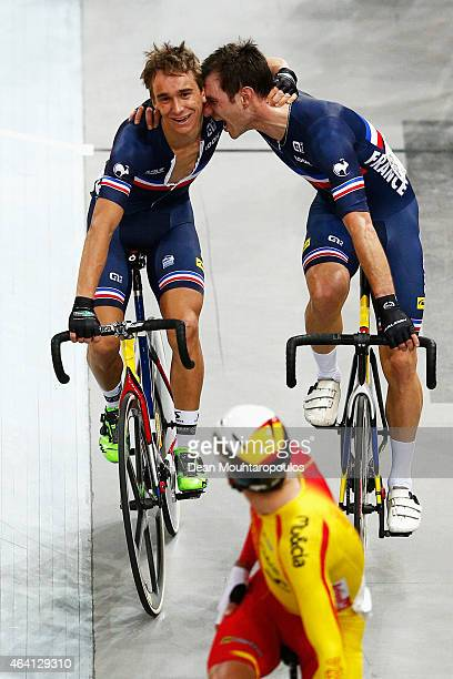 Bryan Coquard and Morgan Kneisky of France celebrate winning the gold medal and world championship in the Mens Madison race during day 5 of the UCI...