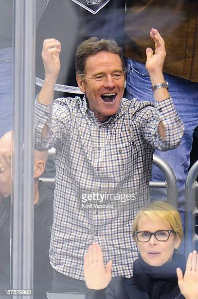 Bryan Cranston attends a hockey game between the Vancouver Canucks and the Los Angeles Kings at Staples Center on November 9, 2013 in Los Angeles,...