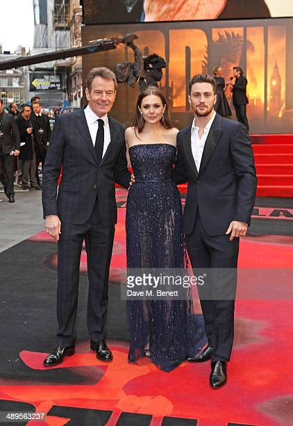 Bryan Cranston Elizabeth Olsen and Aaron TaylorJohnson attend the European premiere of 'Godzilla' at Odeon Leicester Square on May 11 2014 in London...