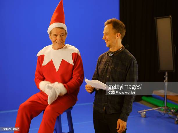 Bryan Cranston receives notes from producer James Longman during a sketch called Elf On A Shelf during 'The Late Late Show with James Corden' Monday...