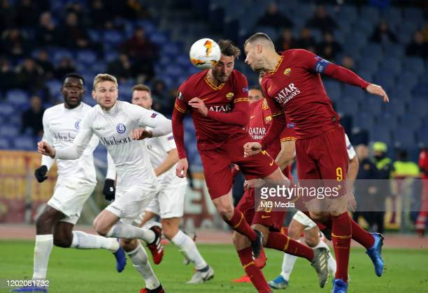 Bryan Cristante and Edin Dzeko of AS Roma head the ball during the UEFA Europa League Round of 32 first leg match between AS Roma and KAA Gent at...