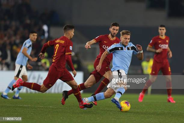 Bryan Cristante and Lorenzo Pellegrini of AS Roma compete for the ball with Ciro Immobile of SS Lazio during the Serie A match between AS Roma and SS...