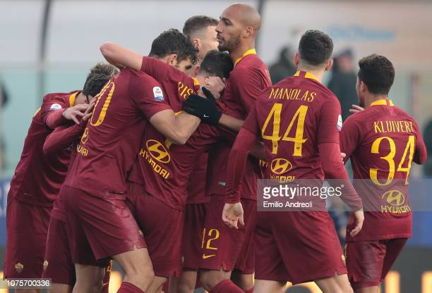 Bryan Cristante of AS Roma celebrates with his teammates after scoring the opening goal during the Serie A match between Parma Calcio and AS Roma at...