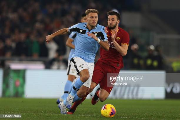 Bryan Cristante of AS Roma competes for the ball with Ciro Immobile of SS Lazio during the Serie A match between AS Roma and SS Lazio at Stadio...